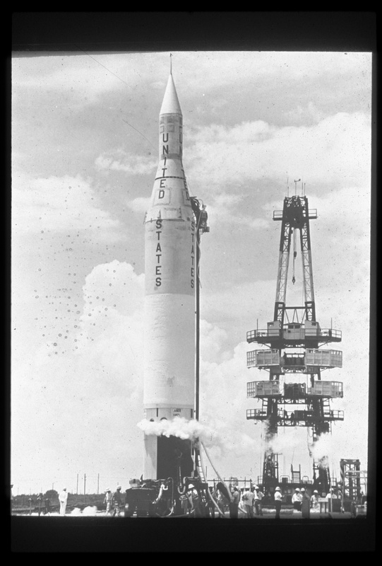 black and white photograph of United States rocket on launch pad with Explorer payload