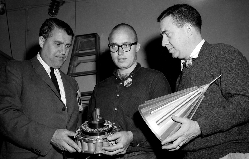 Dr. Wernher von Braun, left, John Casani of the Jet Propulsion Laboratory, center, and Dr. James Van Allen, inspect components of the Pioneer IV spacecraft on March 1, 1959