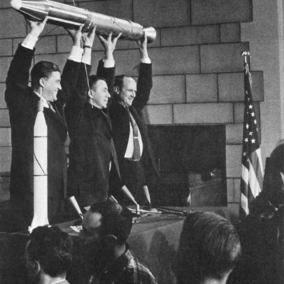 Iconic image of Oickering, Van Allen and Von Braun holding replica of Explorer 1 over their heads