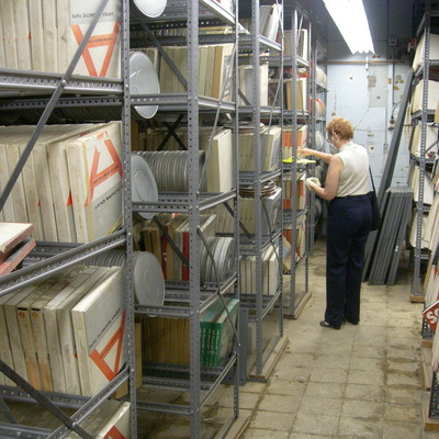 University of Iowa Head of Preservation evaluating data tape conditions in the basement of MacLean Hall