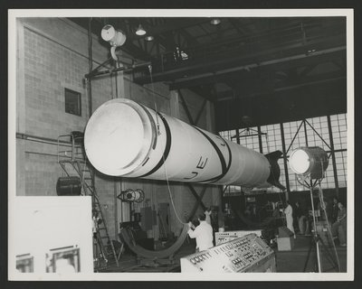 Vanguard rocket body freshly painted being hoisted into rocket cradle